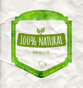 Grünes öko-label mit 100 % natürlichem text, blättern und kleinem vogel. vektorabzeichen auf dem zerknitterten papier. künstlerisches design für naturprodukte (kosmetik, lebensmittel, handwerk).
