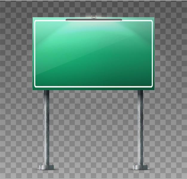 Grünes schild der straßenautobahn mit lichtscheinwerfer