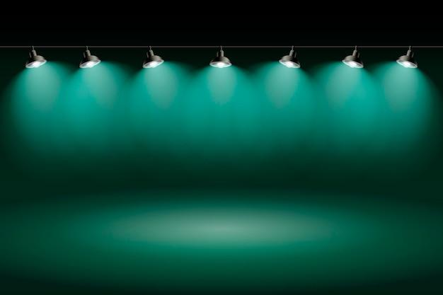Grünes studio des scheinwerferhintergrundes