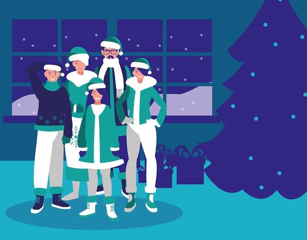 Gruppe der familie mit kleidungsweihnachten im haus