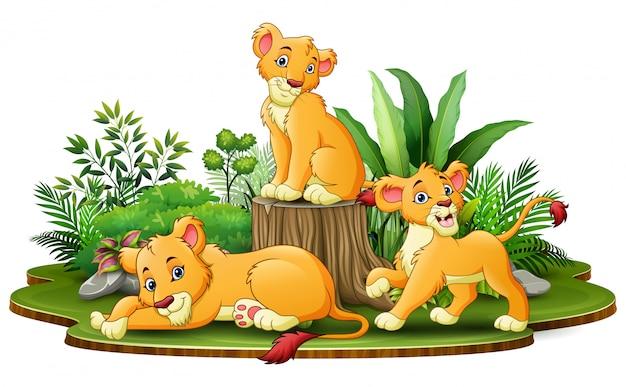 Gruppe der löwekarikatur im park mit grünpflanzen