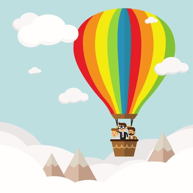 Gruppe des geschäftsmannes, die in den himmel auf heißluftballon fliegt