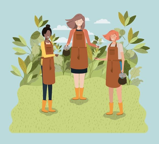Gruppe frauen, die bäume im park pflanzen