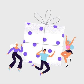 Gruppe fröhlicher leute, die um die große geschenkbox springen.