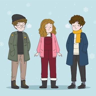 Gruppe junger leute, die kuschelige kleidung für winter tragen