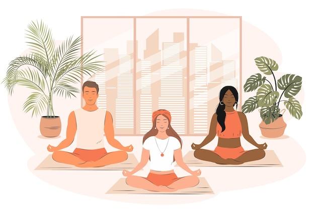 Gruppe verschiedener leute macht yoga und meditiert im fitnessstudio konzept der yogaschule und des sports