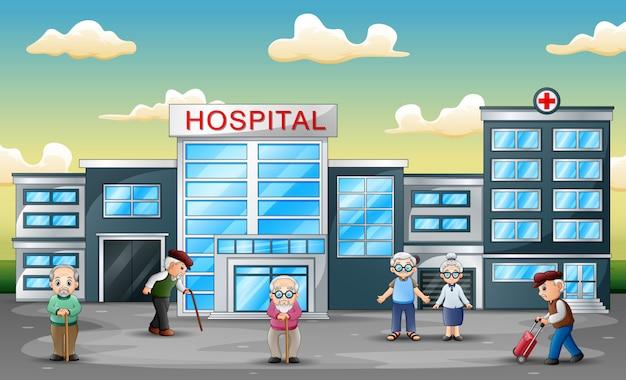 Gruppe von älteren menschen vor dem krankenhaus