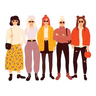 Gruppe von entzückenden frauen gekleidet in trendigen kleidern. illustration.