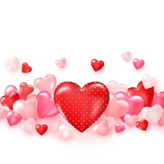 Gruppe von glänzend roten herzen. heller valentinstaghintergrund.