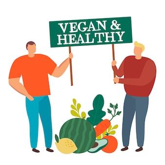 Gruppe von leuten mit großem gemüse, das zeichen vegan und gesund lokalisiert hält.