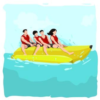Gruppe von menschen fährt bananenboot am strand