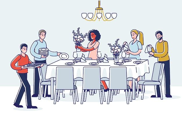 Gruppe von personen, die tisch zum abendessen dienen cartoon männer und frauen, die geschirrgläser und blumen auf tisch setzen