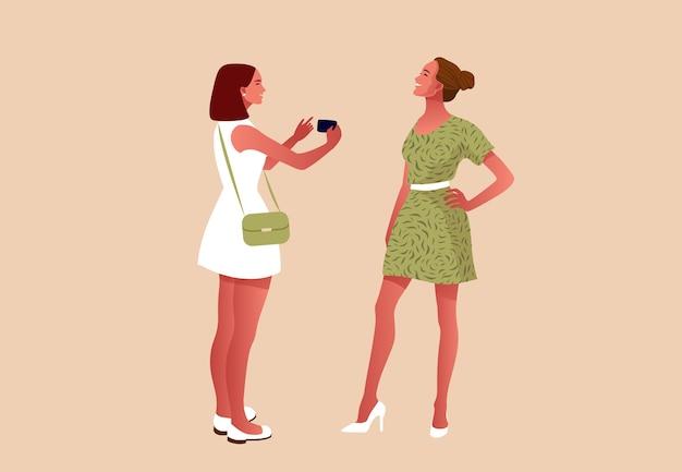 Gruppe von schönen stilvollen freunden, die ein foto mit einem smartphone machen