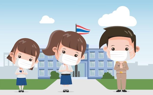 Gruppe von thailändischen schülern und thailändischen lehrern, die mit namaste charakterhaltung grüßen. bangkok thailand lebensstil menschen.