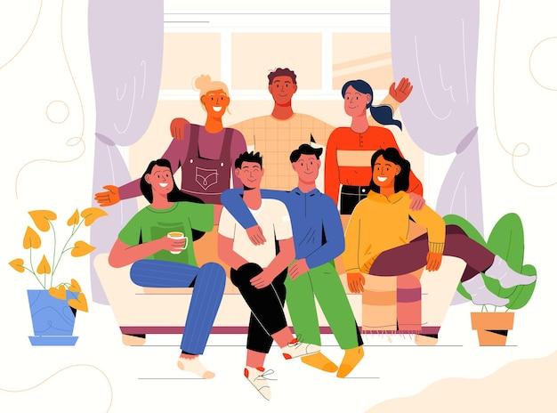 Gruppenporträt von freunden verschiedener nationalitäten treffen. männer und frauen sitzen auf der couch