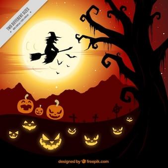 Gruselige halloween-hintergrund mit einer hexe und kürbissen