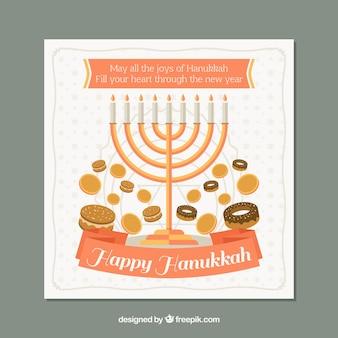 Gruß hanukkah-karte mit süßigkeiten und kerzenleuchter