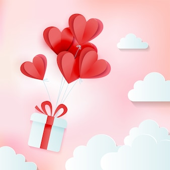 Grußkarte der liebe und des valentinstags mit bündel herz steigt mit geschenk in den wolken im ballon auf. papierschnitt-stil. vektor gemütliche rosa illustration