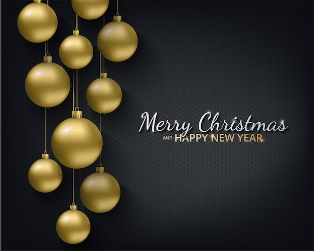 Grußkarte, einladung mit frohem neuen jahr und weihnachten. metallische goldene weihnachtskugeln, dekoration, schimmerndes, glänzendes konfetti auf schwarzem hintergrund.