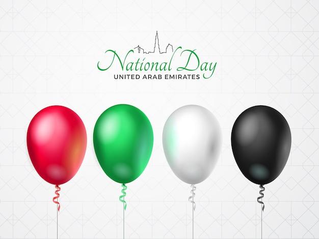 Grußkarte zum glücklichen nationalfeiertag der vereinigten arabischen emirate. luftballons mit emirate flag farben