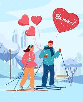 Grußkarte zum valentinstag. paar verliebt skifahren im winterpark mit herzförmigen luftballons unter schneefall.
