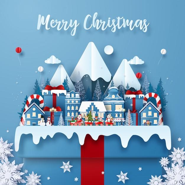 Grußkartenschablone der frohen weihnachten mit zug in der stadt auf einer großen geschenkbox mit santa claus