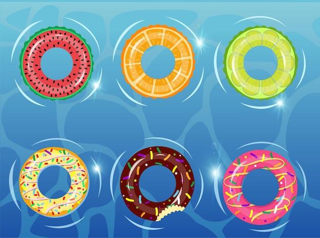 Gummiringe auf dem wasser mit donut wassermelone orange limette schwimmring buntes gummispielzeug