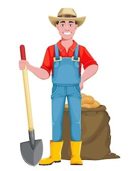 Gutaussehender bauer fröhlicher männlicher bauer-cartoon-charakter mit schaufel und einer tüte kartoffeln