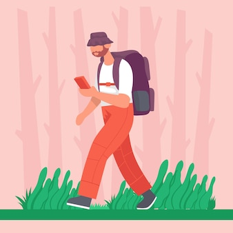 Guy geht mit einem rucksack mit einem telefon in der hand auf wanderung konzept für outdoor-wandern