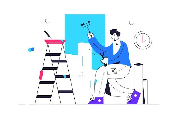 Guy macht moderne renovierungsarbeiten und malt die wände