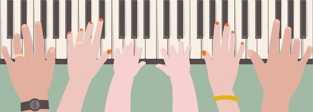 Hände der vatermutter und -kindes, die zusammen klavier spielen