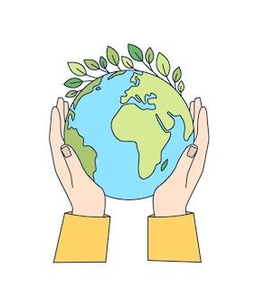 Hände, die den planeten erde mit den grünen blättern halten, die auf ihm isoliert wachsen