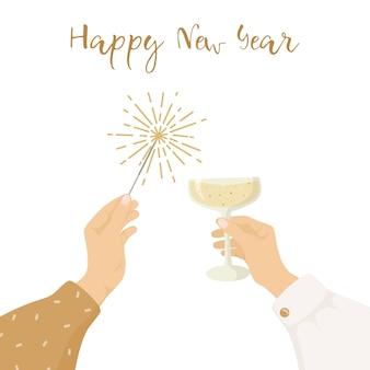 Hände, die ein glas champagner und wunderkerze halten
