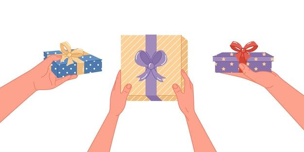 Hände, die eine geschenkbox getrennt auf weißem hintergrund geben. vektor-illustration