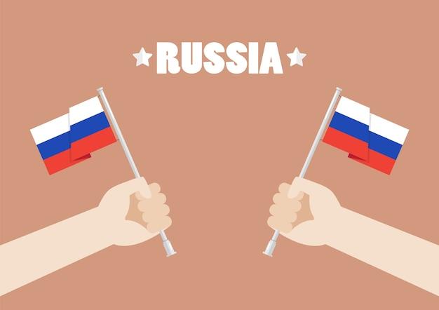 Hände, die russland-flaggen halten