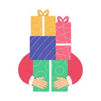 Hände, die viele weihnachtsgeschenkboxen halten weihnachtseinkäufe