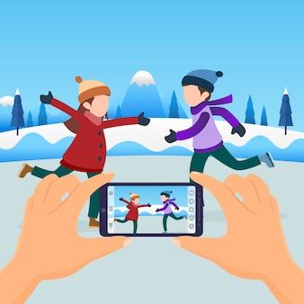 Hände halten den smartphone, der paarfoto macht