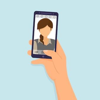 Hände halten den smartphone, der selfie foto macht