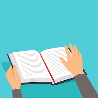 Hände halten offenes buch zum lesen