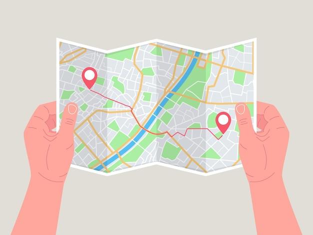 Hände halten papierkarte. gefaltete karte in händen von männern. touristischer blick auf karte der stadt zum fluss, sucht.