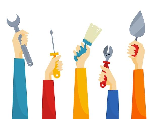 Hände halten verschiedene geräte für eine reparatur
