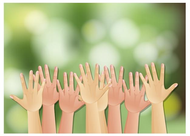 Hände hoch auf grünem hintergrund