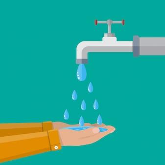 Hände unter fallendem wasser aus dem wasserhahn