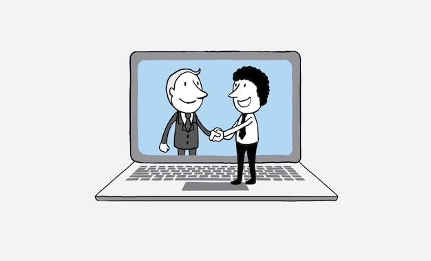 Händedruck von zwei geschäftsleuten auf laptophintergrund.