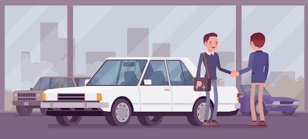 Händler im autohaus zeigt fahrzeug zum verkauf an