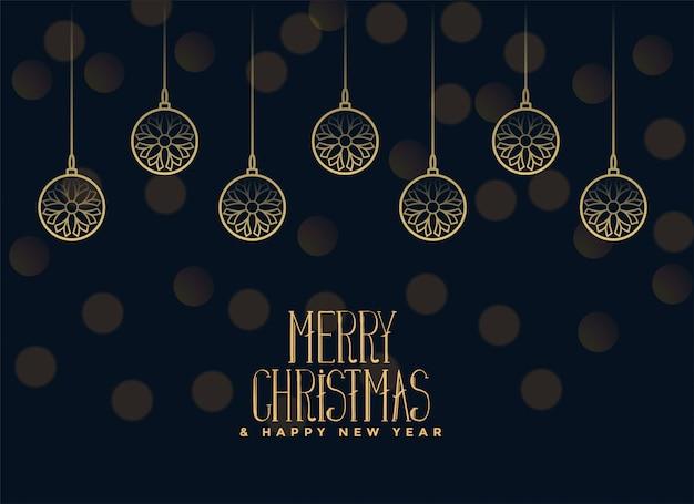 Hängende bälle der frohen weihnachten auf dunklem hintergrund