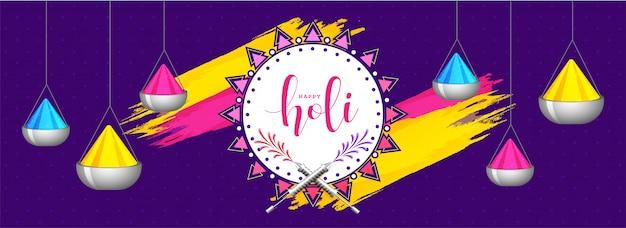 Hängende farbschüsseln auf purpurrotem hintergrund für holi festival heade