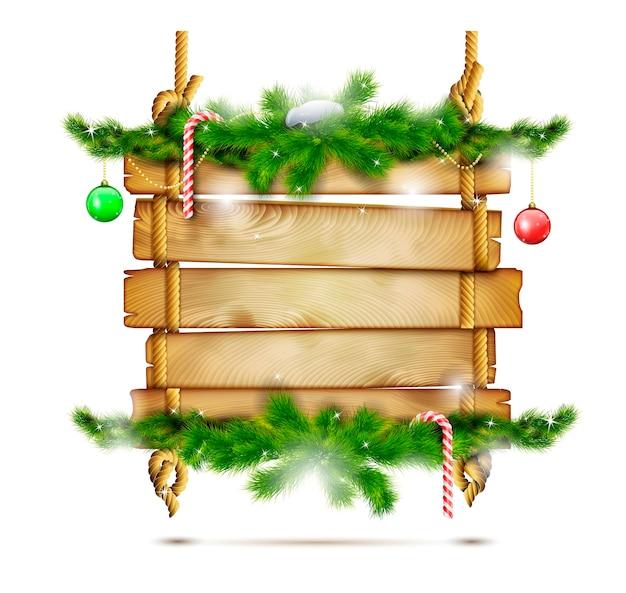 Hängende weihnachtshölzerne anschlagtafel.