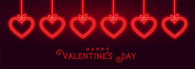 Hängendes neonliebesherz-valentinstagkartendesign