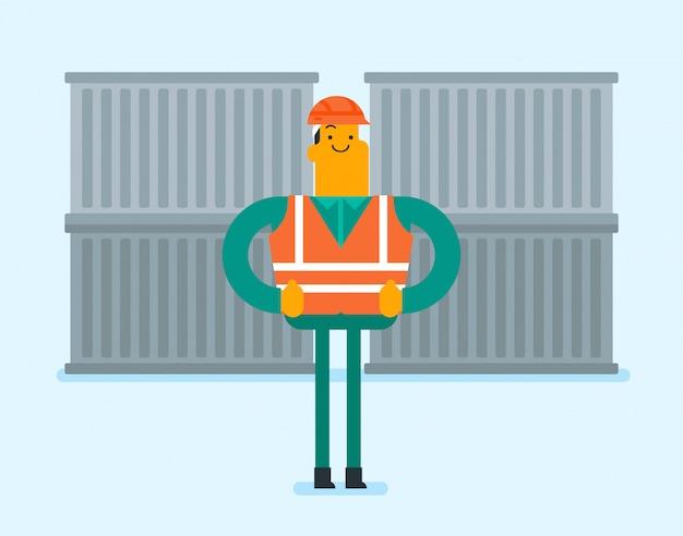 Hafenarbeiter, der auf frachtbehälterhintergrund steht